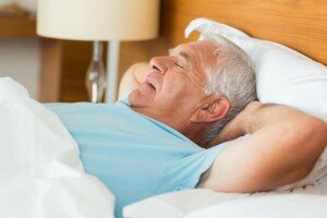 older man sleeping on back