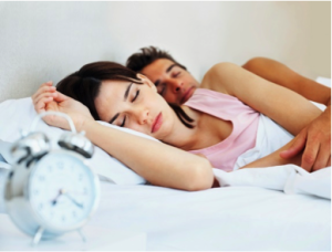 Man and Woman Sleeping in Bed
